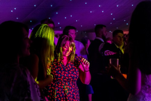 Guest dancing to a mobile disco at Moxhull Hall